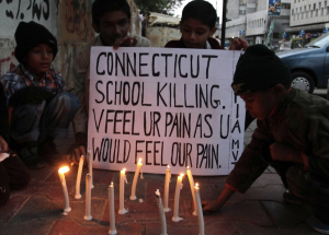 Pakistani kids vigil for U.S. shooting victims